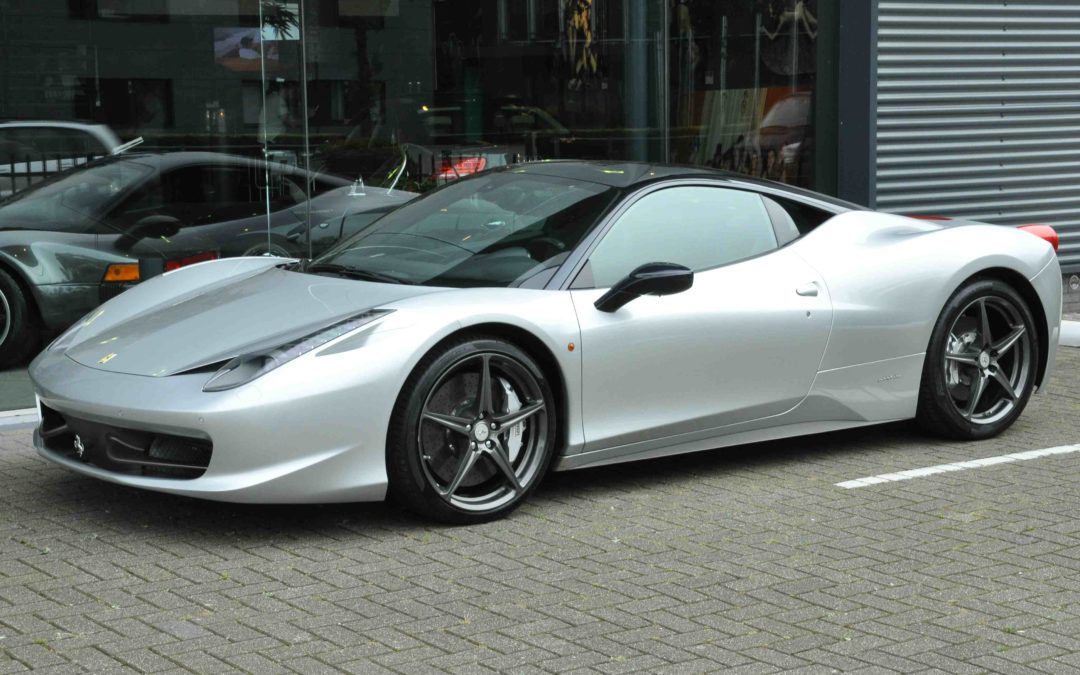 Ferrari 458 Italia in front of a glass wall